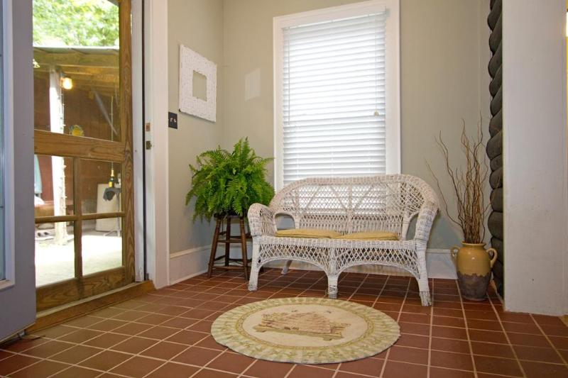 Wicker seating just off kitchen.  Just outside your back door awaits your hot tub.  Enjoy!