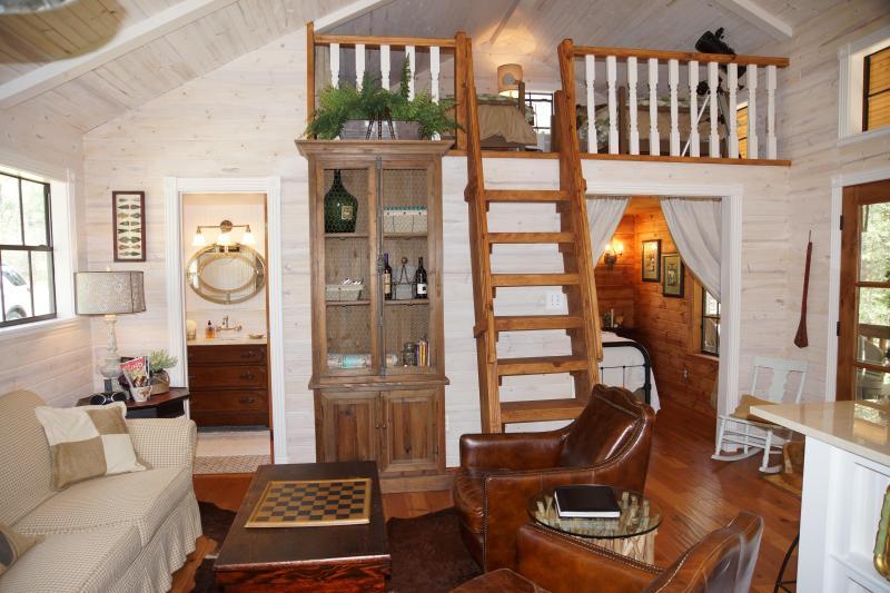 the cozy interior offers a main room, bedroom, bathroom, and loft