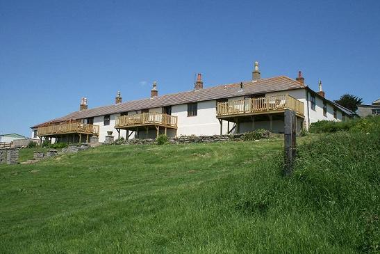 Cogden cottages a former Victorian coastguard station.