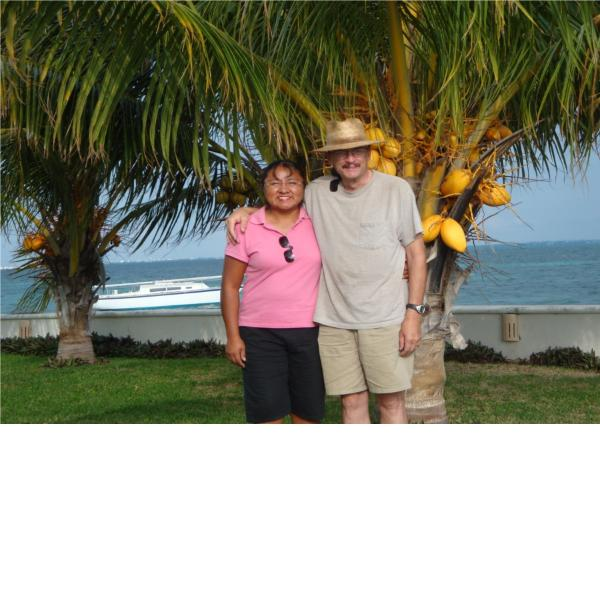 my wife Alam and me , at our coco trees ,,help yourself!