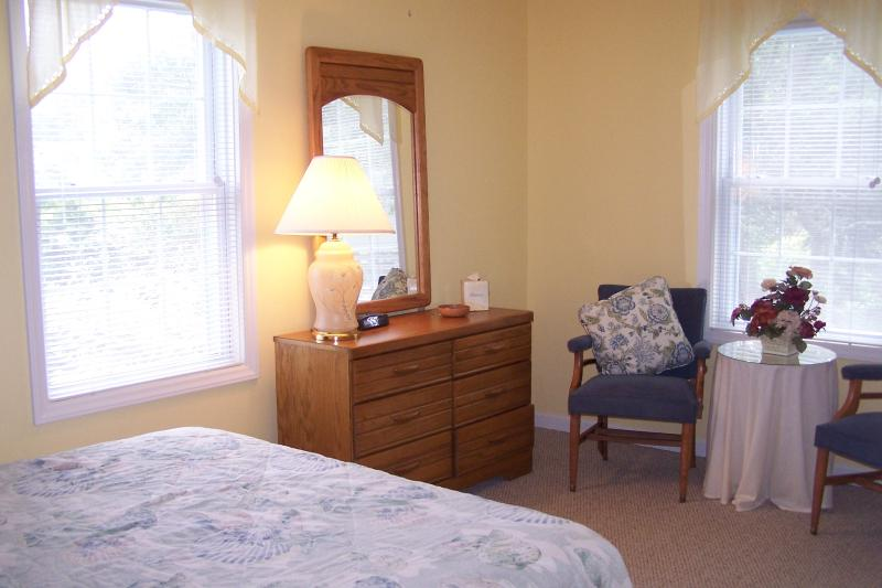 Yellow bedroom has Queen Bed, ceiing fan, walk-in  closet, and linens provided