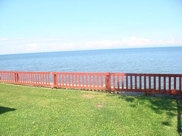 view of the lake in front of cottage