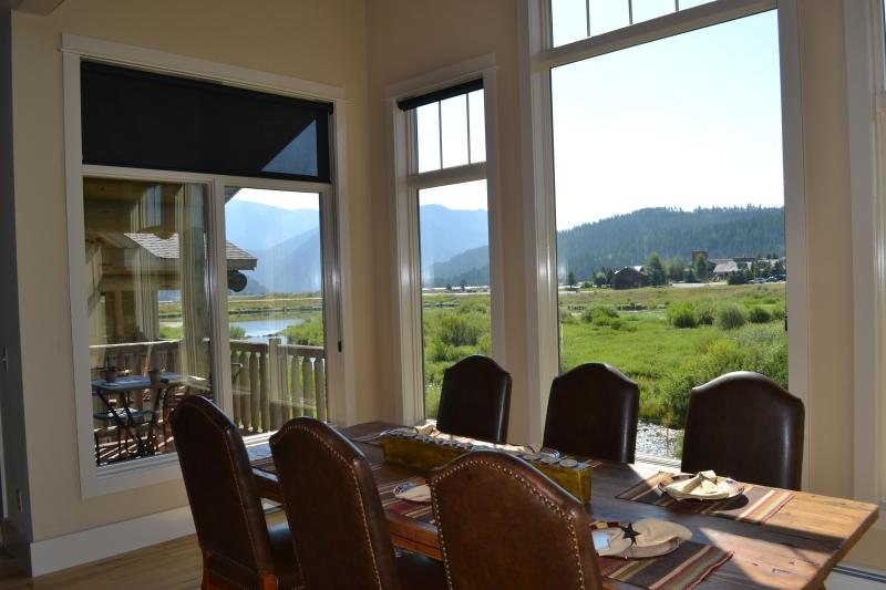 Abundant natural light and gorgeous views from dining room out on to the meadow and creek