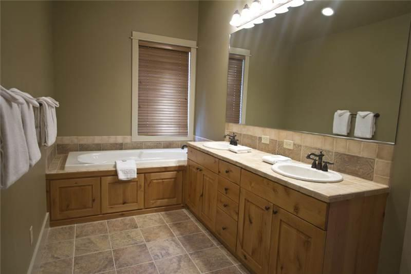 Large master bath; four bathrooms in house, including a sauna and steam shower