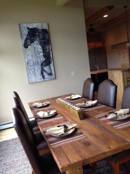Beautiful new dining room table; enjoy meals and look out at river/mtns thru large pictureque window