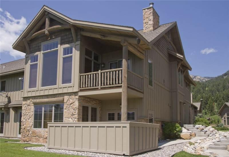 View of townhome from the creek; mountains surround you; grill downstairs is ready to enjoy!