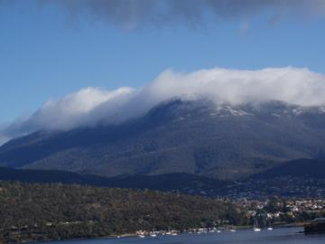 Winter clouds on Mount Wellington from your patio.