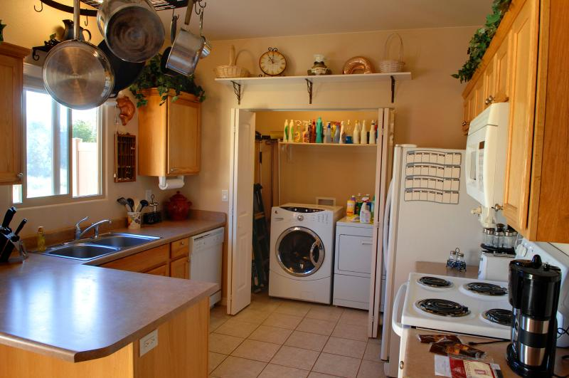 Kitchen Offers Modern Conveniences and is Adjacent to Washer/Dryer
