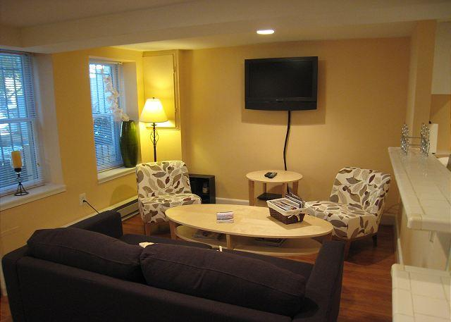 Livingroom with seating for 4 and wall mounted HDTV