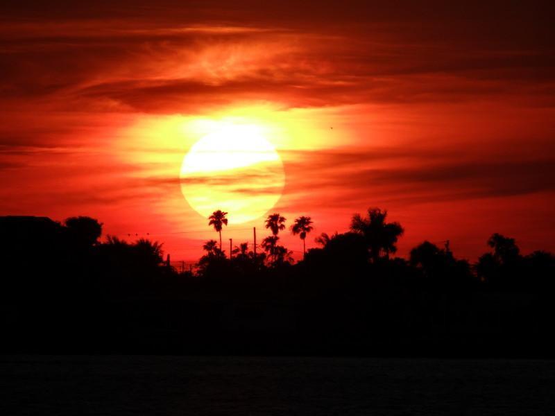 Grote zonsondergangen vanaf lanai