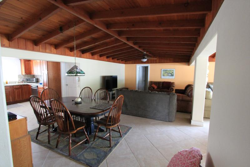 Living and dining room with open ceilings