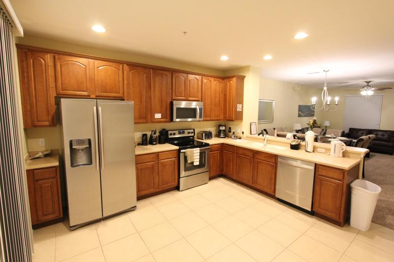 Fully equipped kitchen w/ stainless steel appliances and Corian countertops