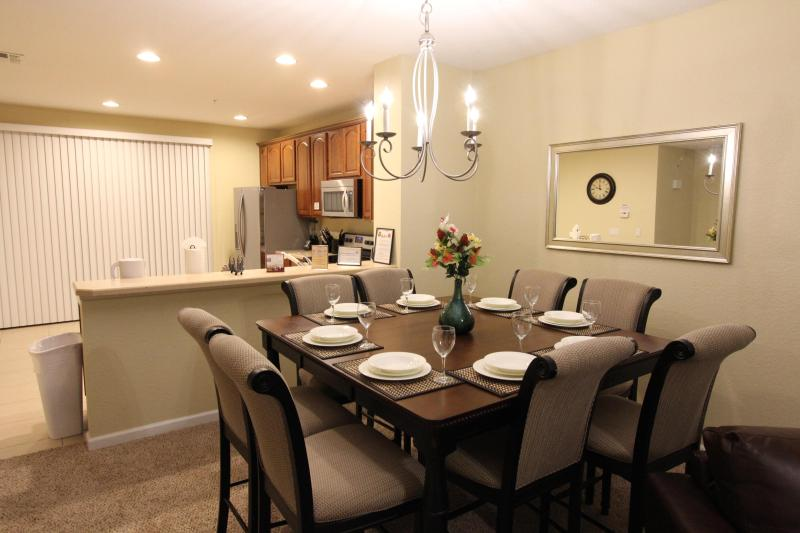 Dining room table with spacious seating for 8 / view of kitchen