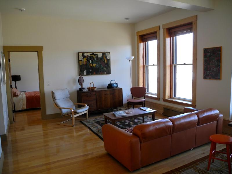 Living room area of the apartment with a view out to the Lamoille River.