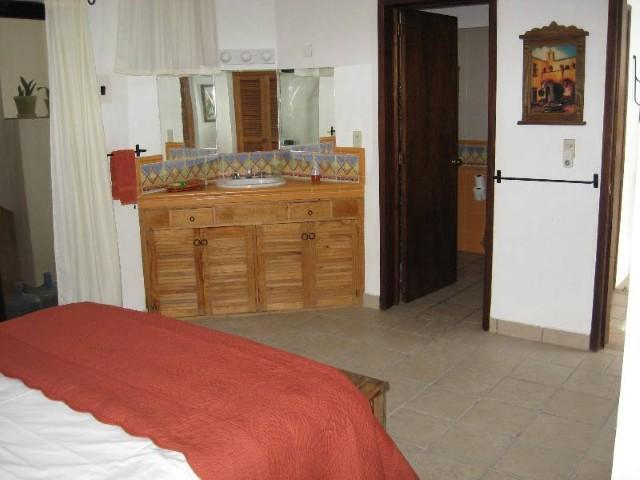 Main Floor Orange Room View 2; Vanity & Private Bathroom