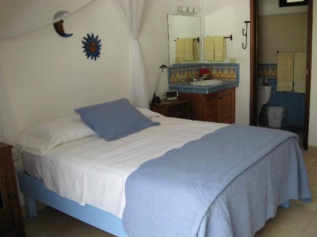 Second Floor Blue Room View 1; Queen Bed, Vanity & Bathroom