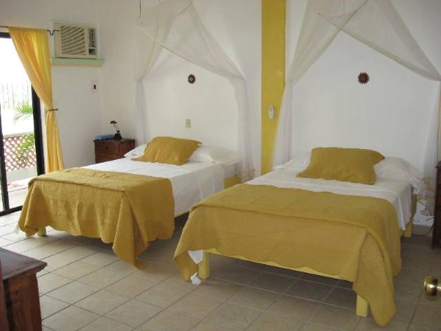 Second Floor Yellow Room View 1; 2 Double Beds & Door to Private Terrace