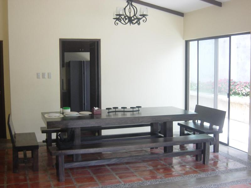 Dining room. Dining table sits 14. Door leads to kitchen.