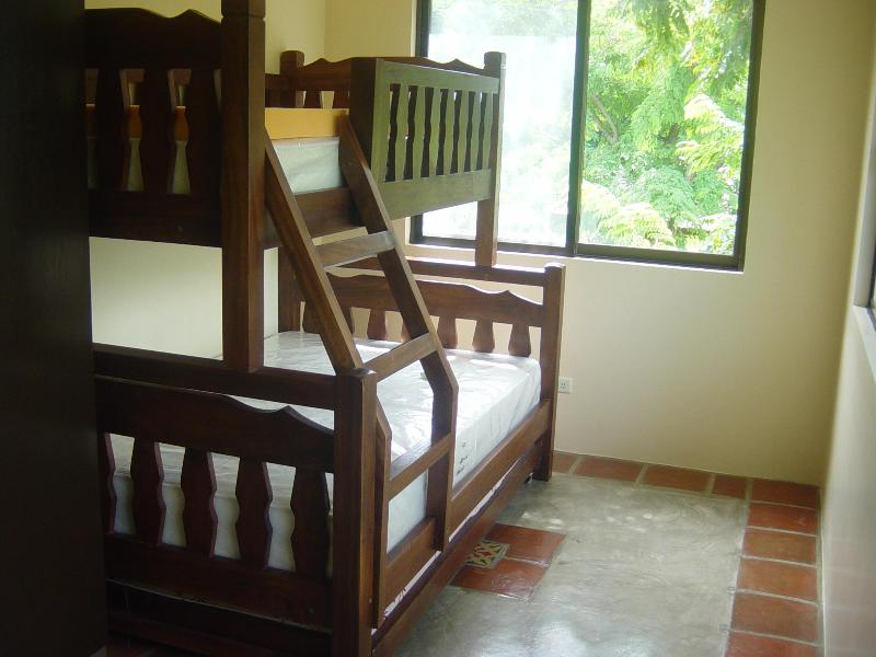 Girls' room at 2nd floor. Triple decker with wheeled pullout. Sleeps 5 pax.