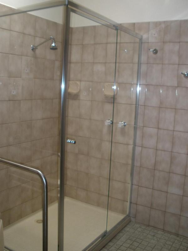 Large bathroom with spa bath