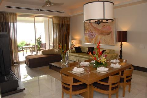 The Luxxe Suite Dining and Living Area (Model)
