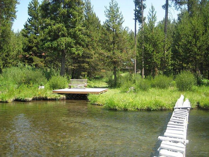 Looking at the dock and cabin from across the creek