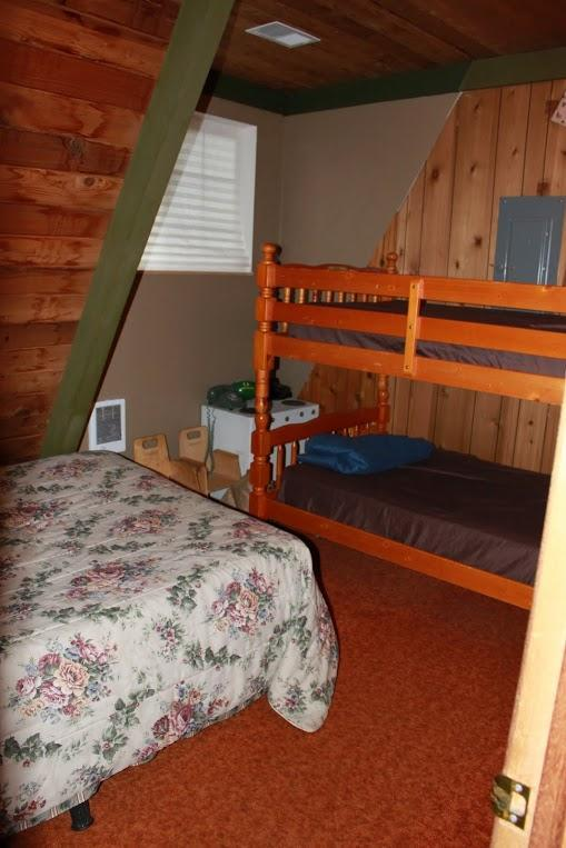 Queen bed and bunk beds in the downstairs bedroom