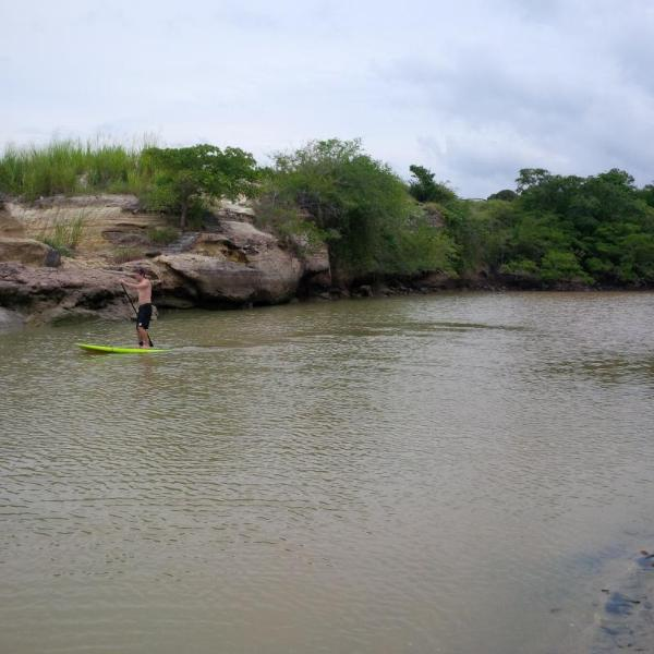 Exploring the river with the stand up paddle boards available to all guests by request.