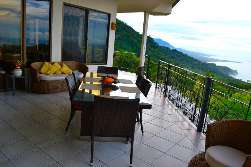 Sunset view patio above the pool with BBQ grill table for 8 people