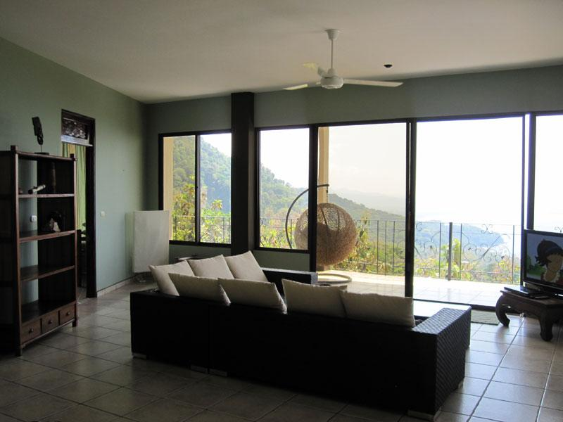 Ocean view & mountain view living room. TV has DVD and satellite TV