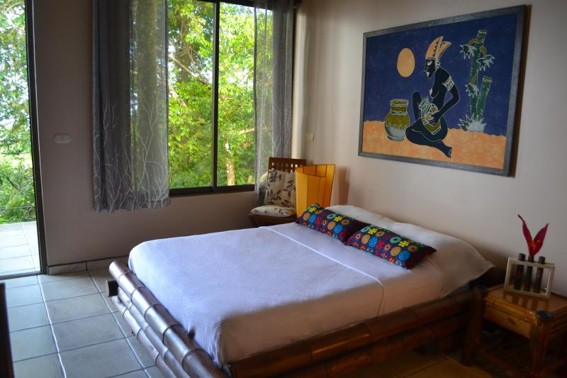 Another bedroom with private bathroom and access to balcony