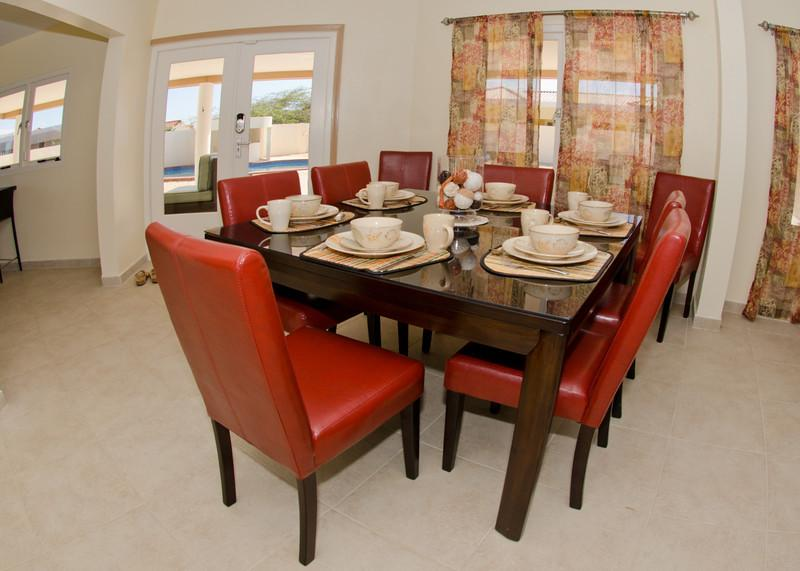 Dine elegantly inside or walk through the french doors to dine casually outside on the verandah.