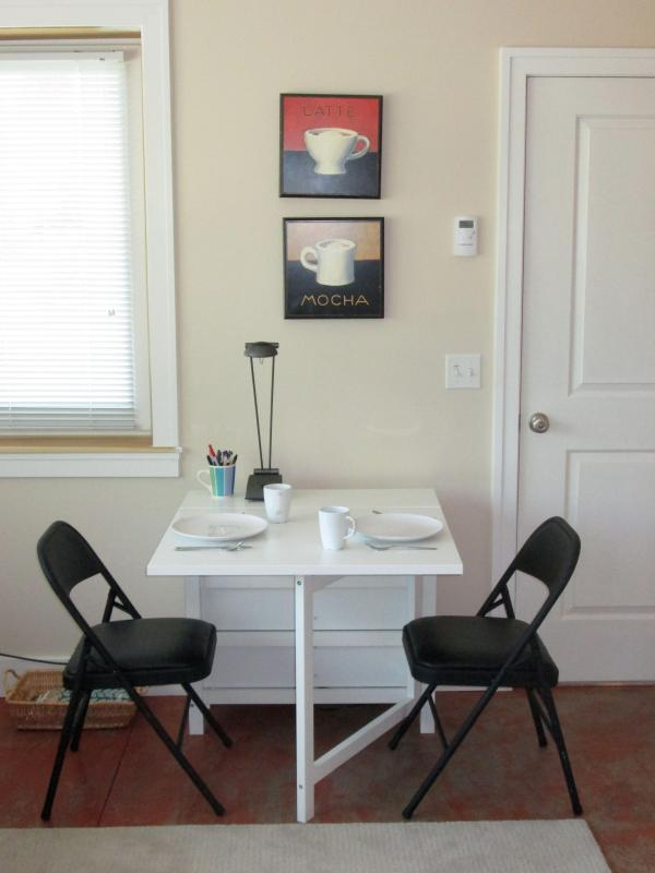 Dining table can be totally folded up or enlarged to fit 4.