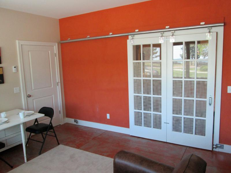 Sliding doors on a steel rail with frosted glass for privacy in the bedroom.