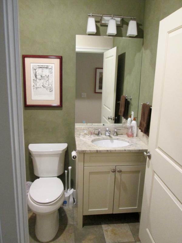 Bathroom sink with a granite top.