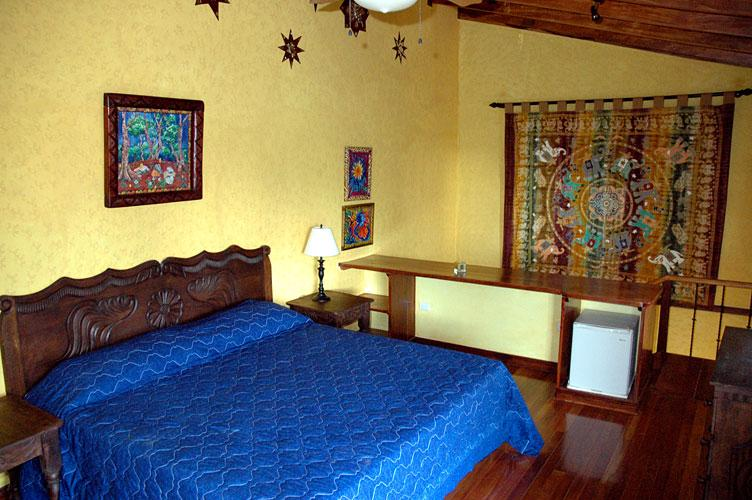 The King's room, a spacious double room, with a king size bed and mini-fridge