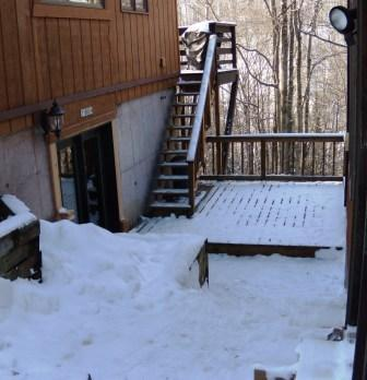 View of lower deck and entrance. Gas grill on the upper deck.