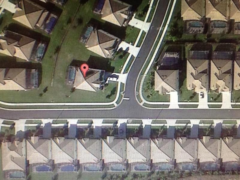 Arial view of our villa.  A wonderful corner lot with a southwest facing pool.