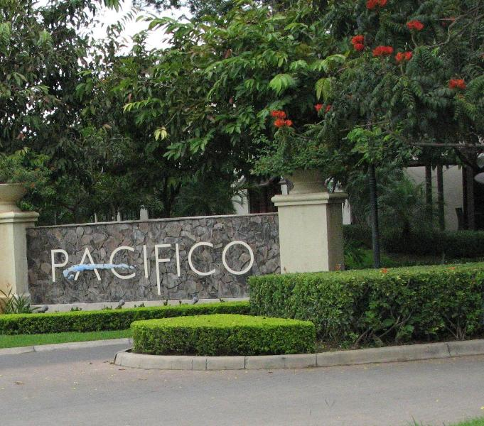Pacifico gated community entry has full service grocery and retail shops a walk away from condo