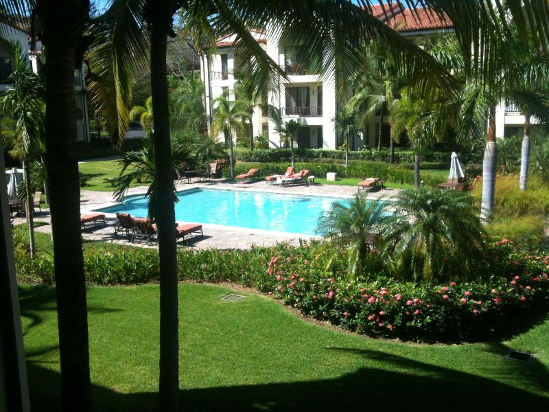 Classic pool overlook from condo's 2nd floor outside deck