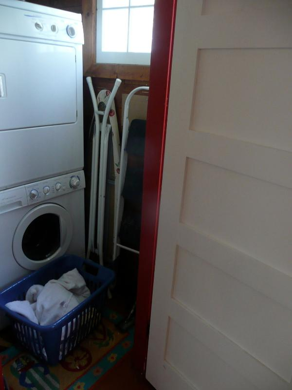 Laundry room with combo front load washer & dryer on top, main floor next to kitchen