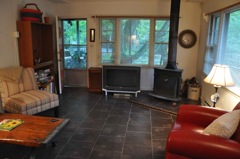 Living Room- Large windows, tile floor, fireplace and comy furniture.