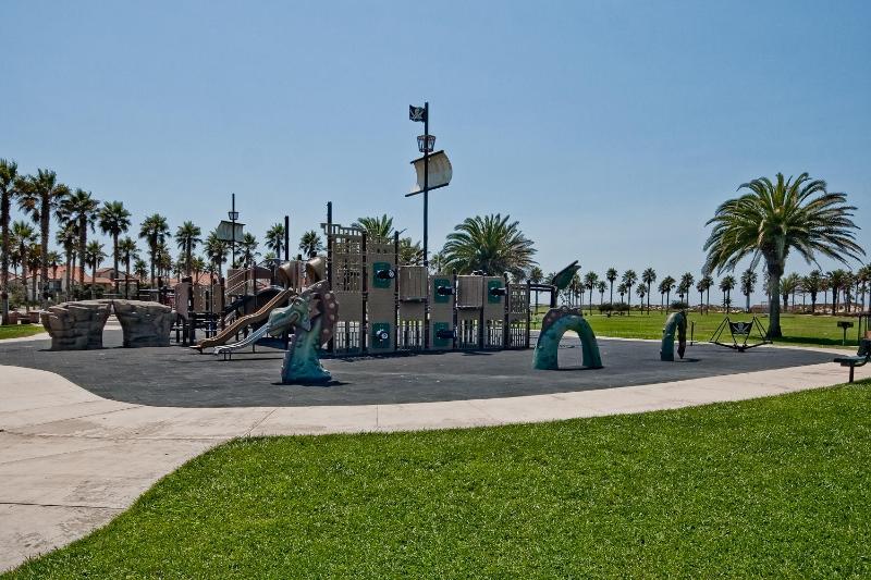 Oxnard Beach park, covered tables, BBQ grills, play areas bathrooms, and beach access.