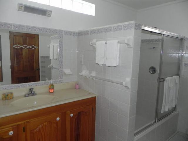 large bathroom with hot and cold shower, and vanity