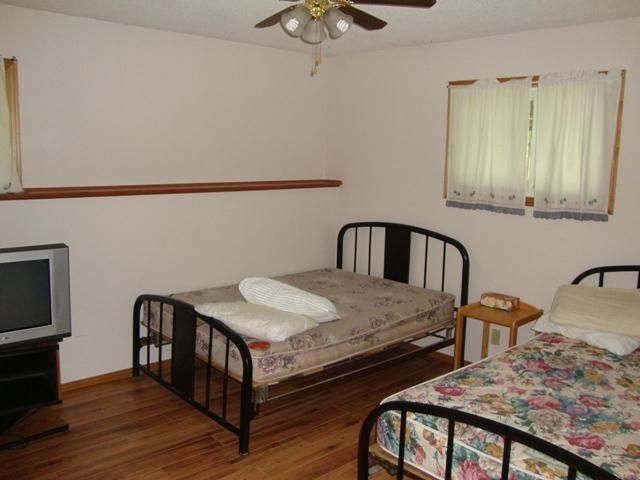 bedroom 1 - basement with 2 x doubles and TYV