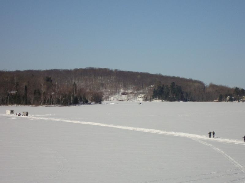 cross country skiing from the house to the ice fishing village , skis use is free