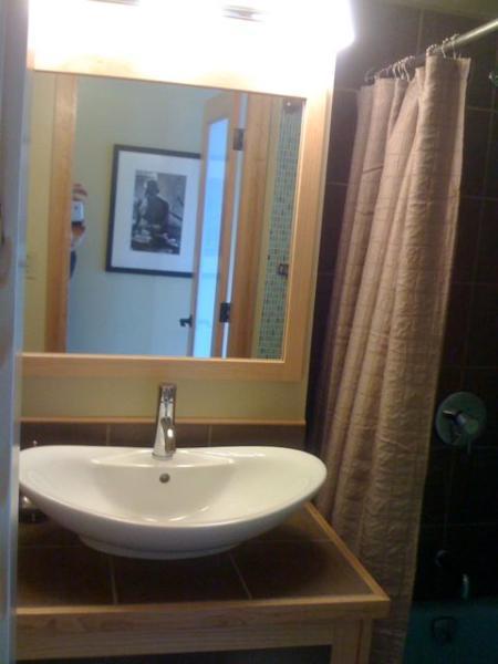 Custom oak and tile bathroom cabinet