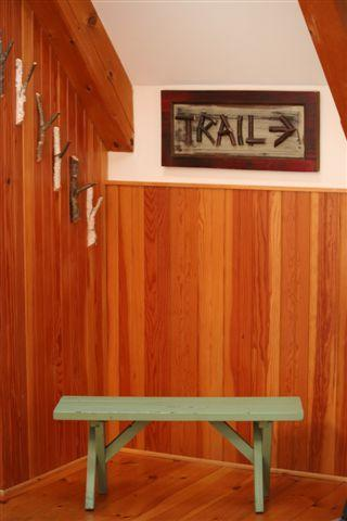 entrance bench and coat hooks to dry your gear on