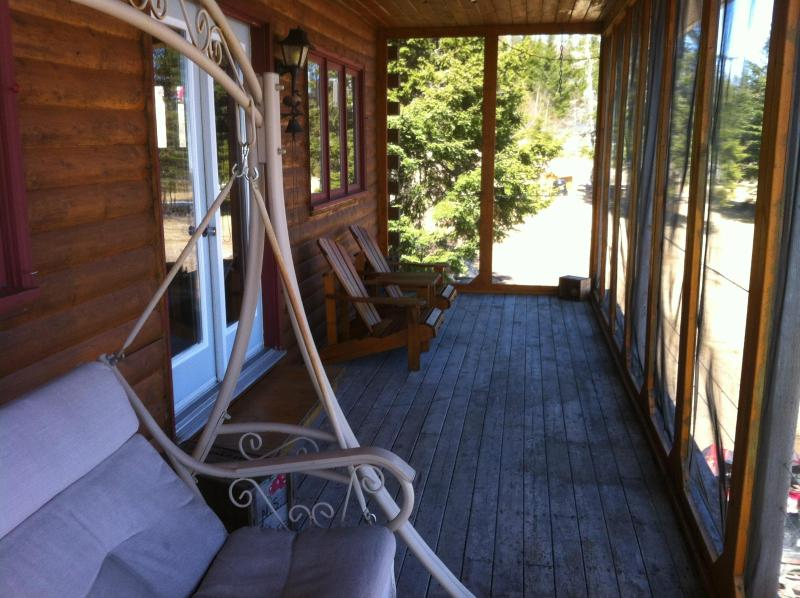 screened in deck over looking lake and gardens