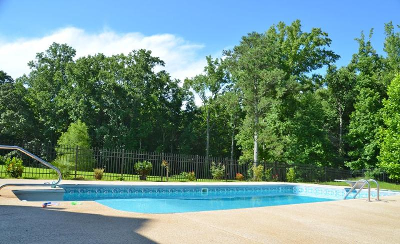 Pool is located just a short walk through the woods over the creek